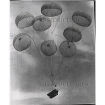 1949 Press Photo Multiple Parachutes in the sky