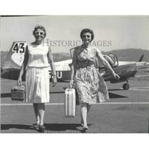 1964 Press Photo Mrs. Harry P. Harper and Mrs. Shirl Shinn walk away from plane