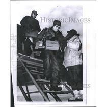 1962 Press Photo Lawrence Eklund departing aircraft at a military base