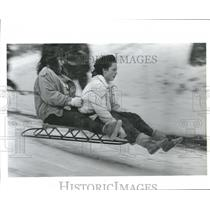 1988 Press Photo Amber Wittenberg and Tiffany Buck sled in Manito Park