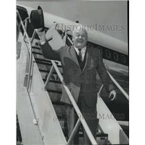 Press Photo Man waving his Bowler Hat while on Stairs beside Airplane