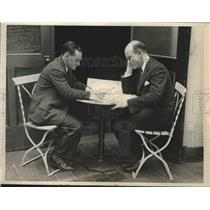 1929 Press Photo Bob Gast and Parker Cramer Look at Trans-Atlantic Flight Plans