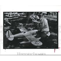 1990 Press Photo Enthusiast pampers his Model Airplane before flight - hca05905