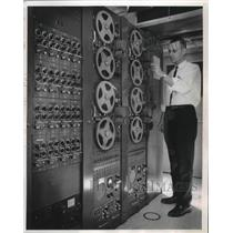 1965 Press Photo Roger Treu Works at Communications Recorder at Mitchell Field