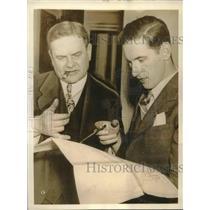 1935 Press Photo Irish Pilot Charles Foley Goes Over Plans of Flight to Dublin