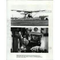 1981 Press Photo John Chotia flying his plane and a worker operates drill press