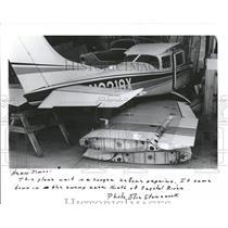 1986 Press Photo plane waits repairs hanger swamp area- RSA05775