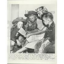 1954 Press Photo Family of Capt Joseph McConnell read telegram - ney30297