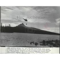 1967 Press Photo Jim Lematta scoops water from Big Lake to dump on forest fire
