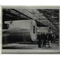 Press Photo Men in plane warehouse - nem48591