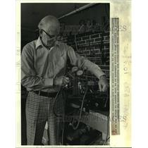 1972 Press Photo Edward Esbrook uses gauge to check conditioner compressor