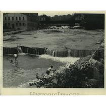 1934 Press Photo People at the water power dam, Sheboygan Falls, Wisconsin.