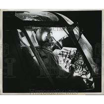 1960 Press Photo Lt. Weems Prepares For Evening Flight on Helicopter Patrol