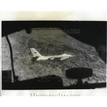 1963 Press Photo Ilyushin bomber viewed flying over a mountain range by MIG Jet