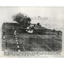 1952 Press Photo Navy Skyraider caught fire while landing on USS Essex deck