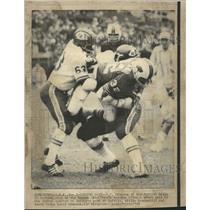 1969 Press Photo O.J. Simpson Carried Away By Defense - RRQ57503