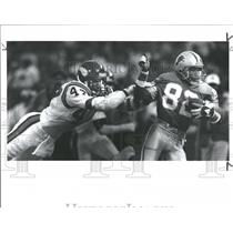 1989 Press Photo Press Lions WR Robert Clark Vikings Joey Brannen - RRQ56619