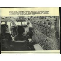 1976 Press Photo Air France Captain Pierre Dudal talks to crew members in flight