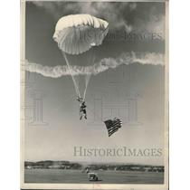 1950 Press Photo Parachute jumper Jack Huber in air with flag in Birmingham