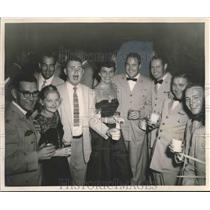 1961 Press Photo Major Riley W. Shamburger, test pilot, with unidentified others