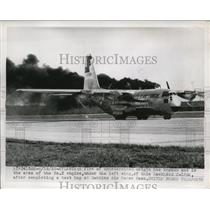 1955 Press Photo Fire Behind Lockheed C-130 A, After Test Hop at Dobbins