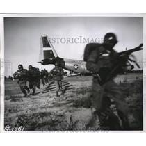 1957 Press Photo American Army Troops emerge from the propjet C-130 Hercules