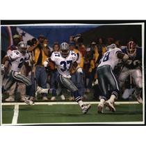 1994 Press Photo Cowboys football safety James Washington runs towards touchdown