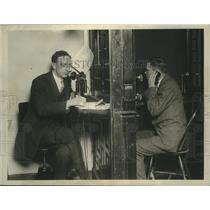 1926 Press Photo Two gentlemen talking on telephones - mjx52924