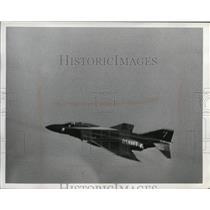 Press Photo McDonnell Douglas F4 Phantom II flies over Burke Tower - nem70642