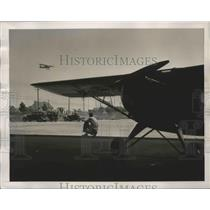 1940 Press Photo Pilot instructor watches his student maneuver in solo flight