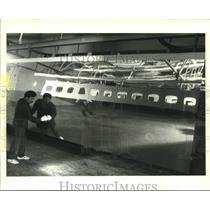 1987 Press Photo Northrop Corporation Tech Finishes Jetliner Panel, California