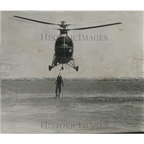 1957 Press Photo Seaman David Thomas Being Picked Up by a Hup-2 Helicopter