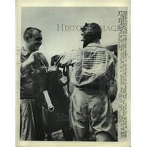 1950 Press Photo Navy Pilots Howard Smith and Walter Bryan at an American Base