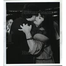 1989 Press Photo Woman from Honduras hugs relatives at Houston airport