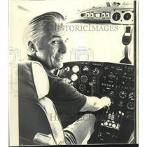 1971 Press Photo Pilot Elgen Long at control panel of light plane - now17468