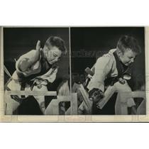 1967 Press Photo Young karate black belt breaks double planks of wood.