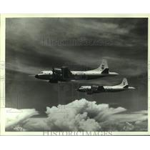 1990 Press Photo P-3c Orim Hurricane Tracker airplanes in flight, Alabama