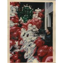 1990 Press Photo Workers Load Balloons for Children's Charity onto Truck