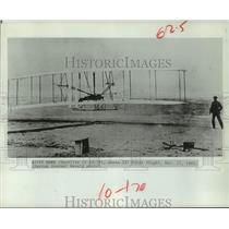 1903 Press Photo Man watching first flight, Kitty Hawk airplane - hcx37377
