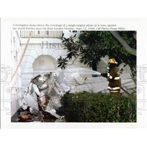 1994 Press Photo Firefighter at White House Plane Wreckage - XXB11179
