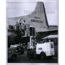 1956 Press Photo Truck hoists onto airlines - RRX31545