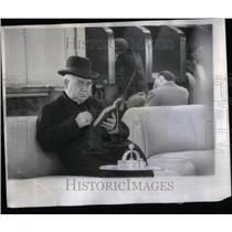 1955 Press Photo Air Passengers Clergyman studies bible - RRU89239