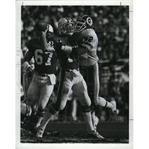 1983 Press Photo Dolphins' David Woodley hit by Redskins' Dexter Manley