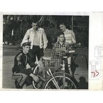 1962 Press Photo Police checks bicycle of Elementary Student. - RSH52509