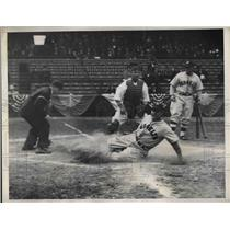 1935 Press Photo Sam Leslie slides home