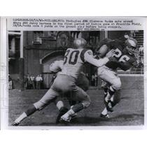1958 Press Photo Clarence Peaks, Eagles, being tackled by Jerry Mertens, 49ers