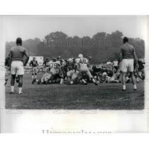 1965 Press Photo Eagles Joe Kantor tackled by Redskins R Harris & C Kamerer