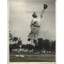1929 Press Photo Boston Red Sox William Regan Jumping for Catch at Training