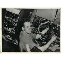 1944 Press Photo Robert Delaney, Famous Composer, Works On WWII Aircraft Engine