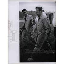 1967 Press Photo Pilot Jim Beele Walking with Press Giving Interview